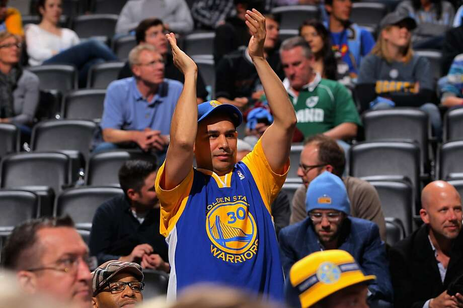 DENVER, CO - APRIL 23:  A fan supports the Golden State Warriors against the Denver Nuggets during Game Two of the Western Conference Quarterfinals of the 2013 NBA Playoffs at the Pepsi Center on April 23, 2013 in Denver, Colorado. The Warriors defeated the Nuggets 131-117. NOTE TO USER: User expressly acknowledges and agrees that, by downloading and or using this photograph, User is consenting to the terms and conditions of the Getty Images License Agreement.  (Photo by Doug Pensinger/Getty Images) Photo: Doug Pensinger, Getty Images