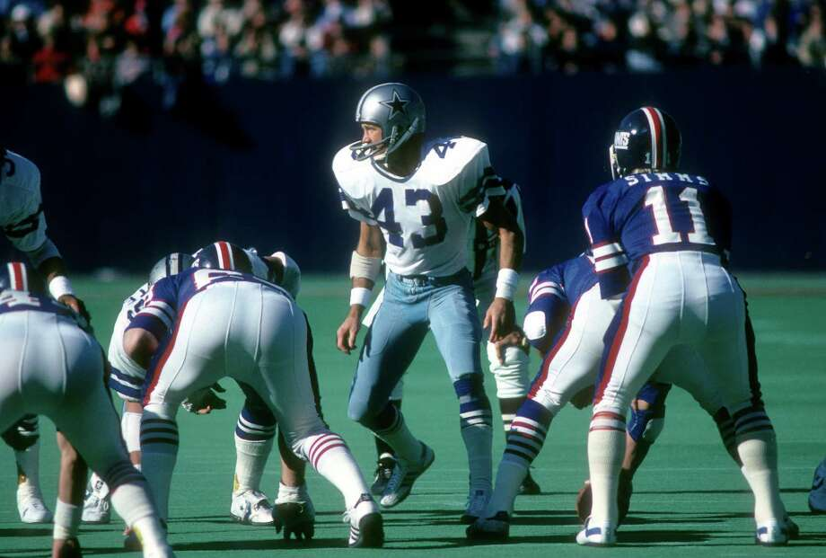 """Dallas Cowboys, S Cliff Harris, Ouachita Baptist. Nicknamed """"Captain Crash,"""" the 6-time Pro Bowler and 3-time All-Pro collected 29 interceptions and 16 fumble recoveries. Teamed with Charlie Waters to form the league's best safety tandem of the '70s. Played in 5 Super Bowls.   PHOTO: Harris (43) looks to blitz New York Giants quarterback Phil Simms (11) during an NFL football game Nov. 4, 1979, at Giants Stadium in East Rutherford, N.J. Photo: Focus On Sport, Getty Images / 1979 Focus on Sport"""