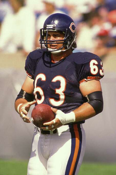 Chicago Bears: C-G Jay Hilgenberg, Iowa. Made 7 straight trips to the Pro Bowl from 1985-91 and was selected a 2-time All-Pro during a 12-year career. Starting in 1983, he was a member of a line that produced seven top-3 rushing offenses in eight seasons and won a ring in the '85 Super Bowl.  PHOTO: Hilgenberg (63) looks on during a NFL football game against the Cincinnati Bengals on Sept. 12, 1989 at Soldier Field in Chicago. Photo: Mitchell Layton, Getty Images / 2009 Mitchell Layton