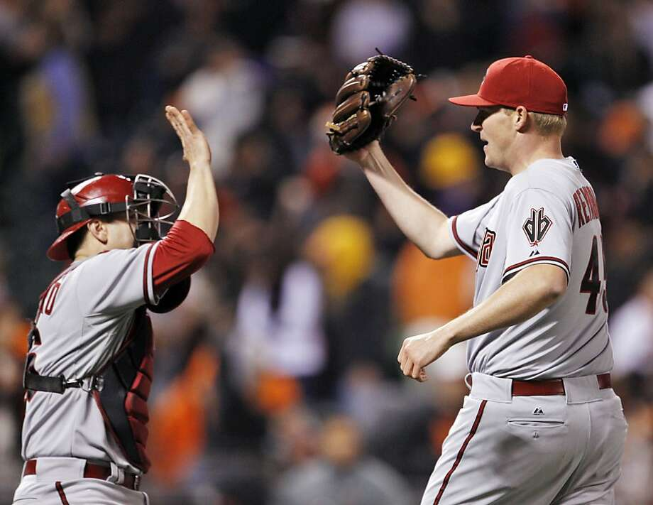 Matt Reynolds, right, and Miguel Montero, left, high five after Brandon Crawford grounded out in the eleventh inning to end the game. The San Francisco Giants played the Arizona Diamondbacks at AT&T Park in San Francisco, Calif,. on Tuesday, April 23, 2013. Photo: Carlos Avila Gonzalez, The Chronicle