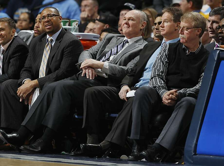 As time dwindles in the fourth quarter, Denver Nuggets head coach Geoge Karl, second from left, reacts to his team's struggles along with assistant coach Melvin Hunt, left, assistant coach John Welch and head trainer Jim Gillen, right, as the Golden State Warriors claim a 131-117 victory over the Nuggets in Game 2 of the teams' NBA first-round playoff series in Denver on Tuesday, April 23, 2013. (AP Photo/David Zalubowski) Photo: David Zalubowski, Associated Press