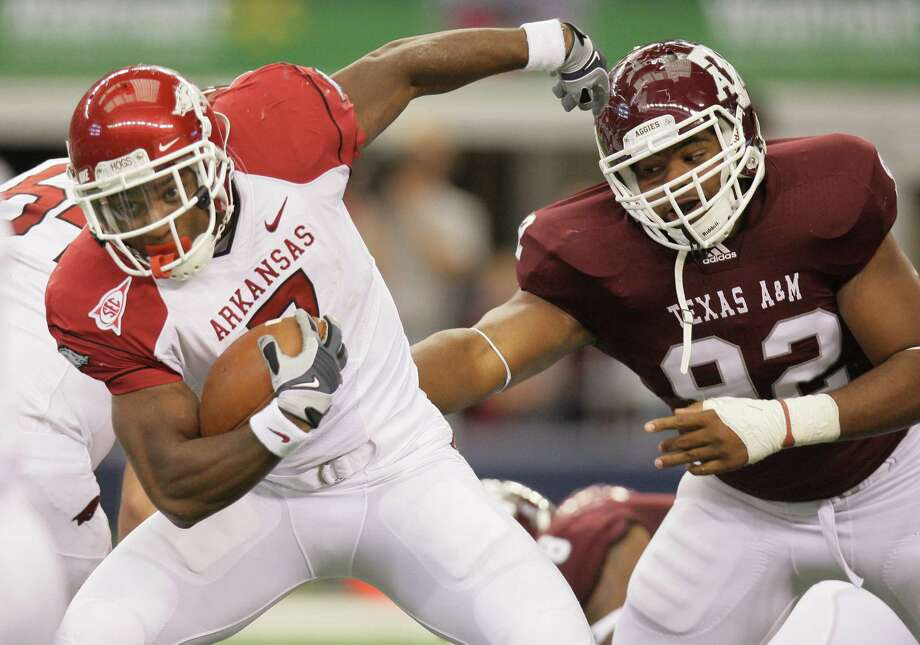 DL Jonathan Mathis, Houston: Mathis (92), seen here chasing Arkansas running back Knile Davis (7) during a 2010 game, should go late in the NFL draft (Rounds 6-7). Photo: Mike Fuentes, Associated Press