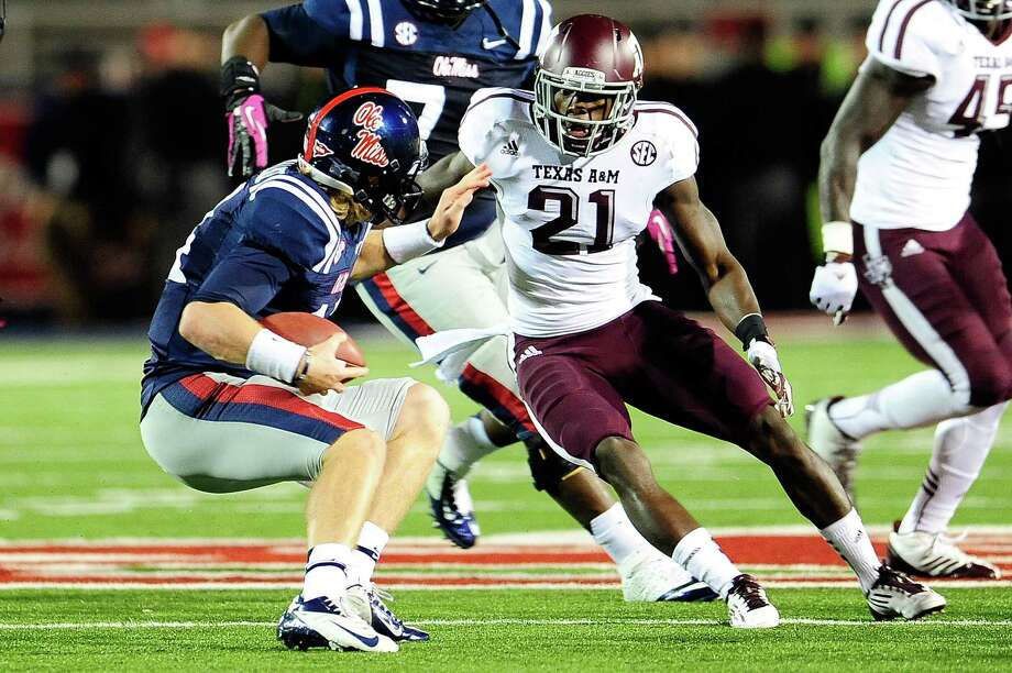 DB Steven Terrell, Allen: Terrell (21), seen here attempting a tackle on Mississippi's Bo Wallace on Oct. 6, 2012, should go late in the NFL draft (Rounds 6-7). Photo: Stacy Revere, Getty Images / 2012 Stacy Revere