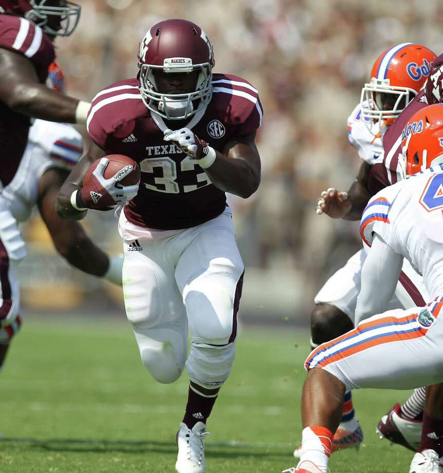 Texas A&M running back ChristinaMichael (33), running against the Florida defense on Sept. 8, 2012, was drafted by the Seattle Seahawks at the end of the second round. Photo: Nick De La Torre, Houston Chronicle / © 2012  Houston Chronicle