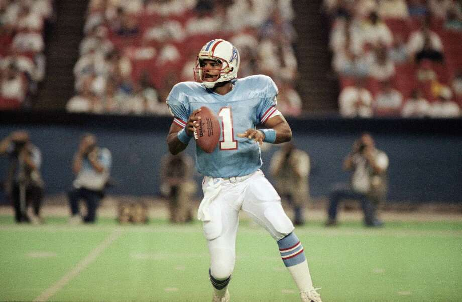 Houston Oilers choice: QB Warren Moon, Washington. Nine-time Pro Bowler elected to Hall of Fame in '06. PHOTO: Moon looks to pass shortly before the ball is knocked away by Detroit Lions Leon Cole in the first quarter on Aug. 9, 1990, in Houston. The Lions recovered the fumble that led to a Lions touchdown. Photo: David Scarbrough, Associated Press File Photo