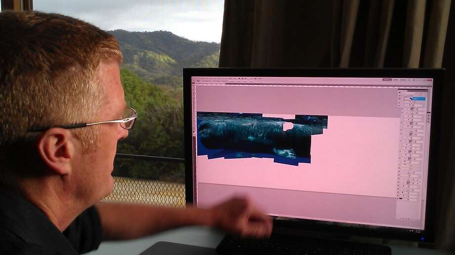Bryant Austin works on his whale photographs at his studio.