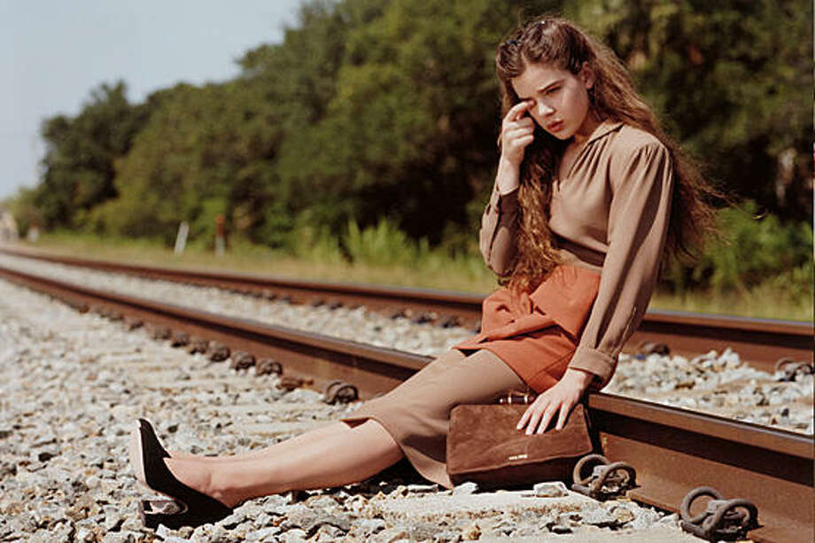 "A 14-year-old wunderkind sitting on train tracks? UK advertising censors didn't approve of the 2011 Miu Miu print ad and said it is ""showing a child in a dangerous situation."" Photo: Miu Miu"
