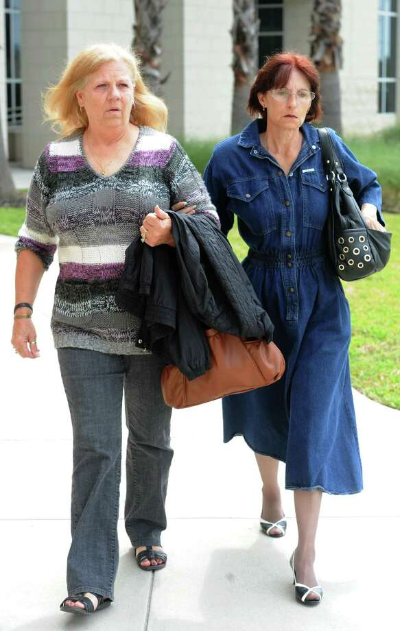 Vickie Hollingsworth, left, testified Tuesday in the Bartholomew Granger capital murder trial. Hollingsworth was a witness to 79-year-old Minnie Ray Sebolt's death. After testifying, Hollingsworth left the Galveston Courthhouse with Sebolt's daughter, Deborah Ray Holst. Photo taken Tuesday, April 23, 2013 Guiseppe Barranco/The Enterprise Photo: Guiseppe Barranco, STAFF PHOTOGRAPHER / The Beaumont Enterprise