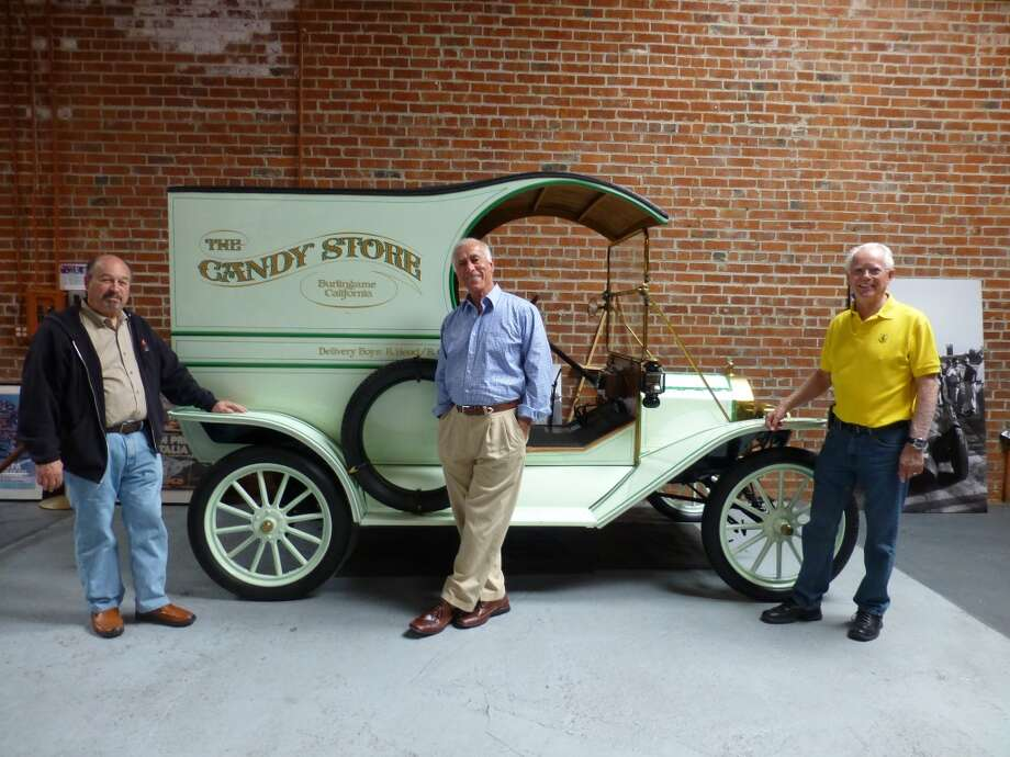 (From left to right), Ron Laurie, Robert Cory and David Buchanan in front of a Model T at The Candy Store.
