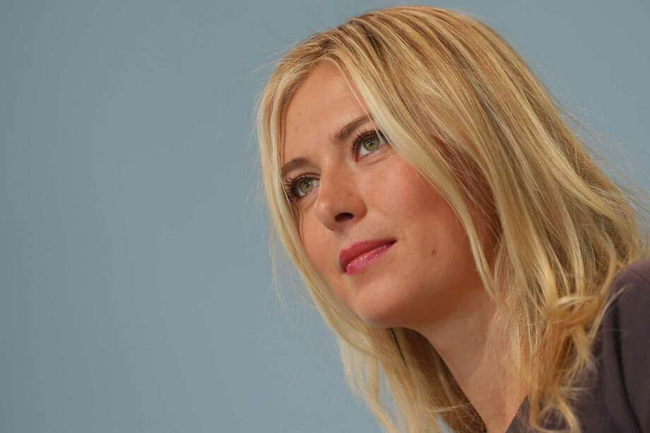 STUTTGART, GERMANY - APRIL 22:  Tennis player Maria Sharapova smiles during a presentation as she is unveiled as car manufacturer Porsche's new brand ambassador at the Porsche Museum on April 22, 2013 in Stuttgart, Germany. Photo: Alexander Hassenstein, Getty Images / 2013 Getty Images