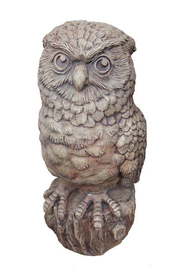 Garden Statue Add an accent to your garden with this 16-inch stone owl statue in a warm hickory color. $57 at George's Market and Nursery.
