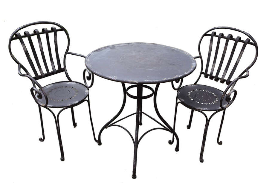 Bistro Set With two garden-style chairs and a table, this wrought-iron antique black bistro set suits any outdoor space. $399 at Faddegon's Nursery.