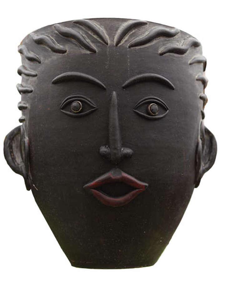 Ceramic PlanterHuman-face ceramic planters add character to any garden. $59.99 at Faddegon's Nursery.