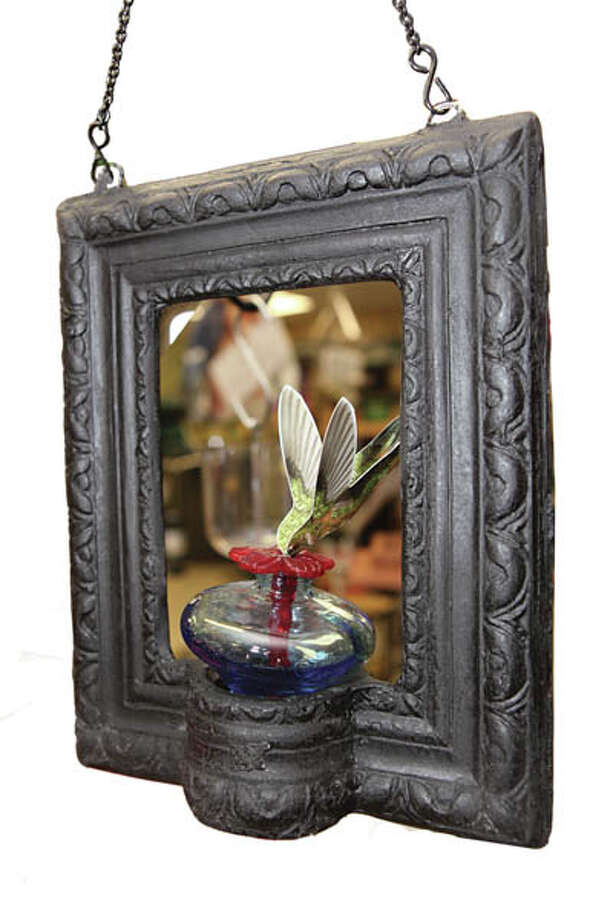 Bird FeederThis hummingbird feeder disguised as a mini-blossom picture frame is handmade with recycled materials. $56.95 at Back Yard Birds.