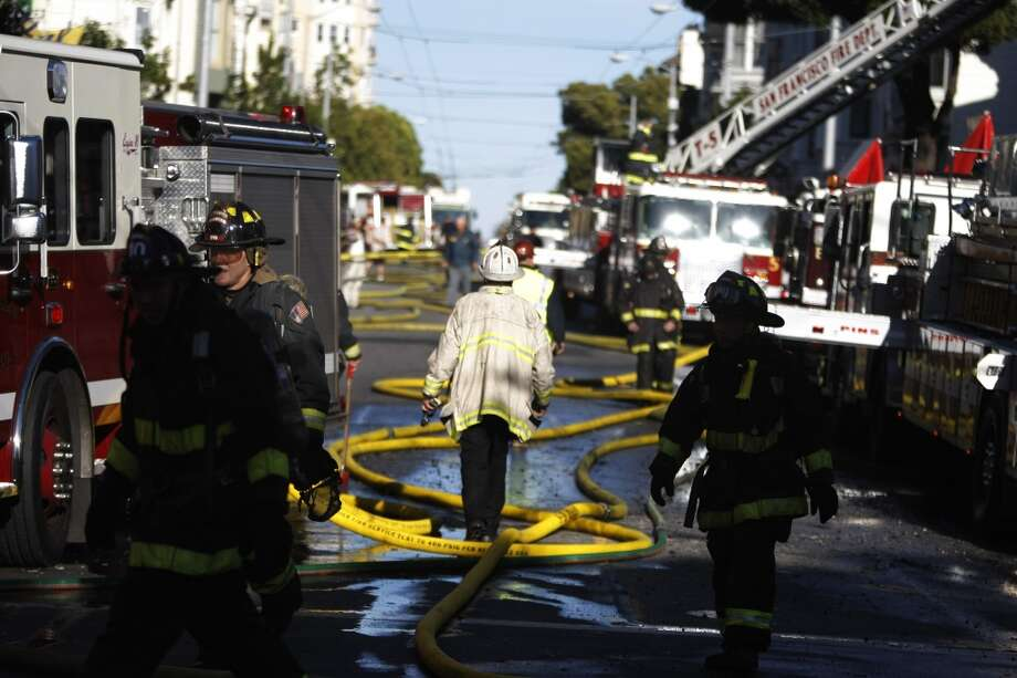 Firefighters fill Haight St. after dousing a large fire on the corner of Haight St. and Fillmore St. in San Francisco, Calif., on Tuesday, Sept. 27, 2011.