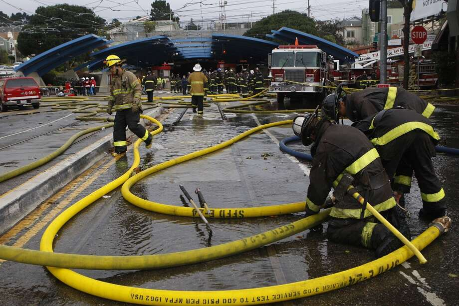 Firefighters ending a fire which started around 5:00am at the Squat and Gobble restaurant in West Portal in San Francisco, Calif., on Friday, October 12, 2012.  The fire prompted the shutdown of three Muni lines.