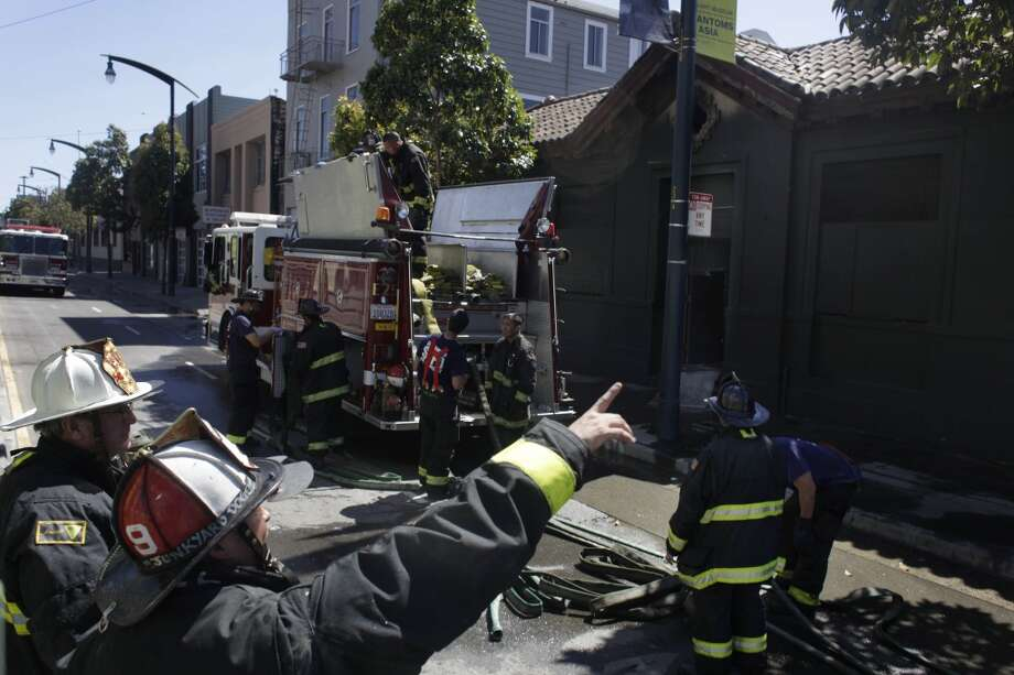 Firefighters work in front of the former Potrero police station, which closed more than 15 years ago, on Tuesday, May 22, 2012 in San Francisco, Calif.  A two alarm fire broke out at the former Potrero police station on the corner of Third and 20th Streets on Tuesday afternoon.