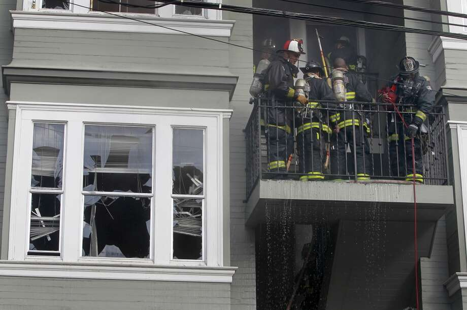 Firefighters work on the stairway of a building on 23rd Street, one of five structures heavily damaged by a 3-alarm blaze near the corner of Capp Street, in San Francisco, Calif. on Saturday, Dec. 29, 2012. At least one firefighter was injured in the fire.