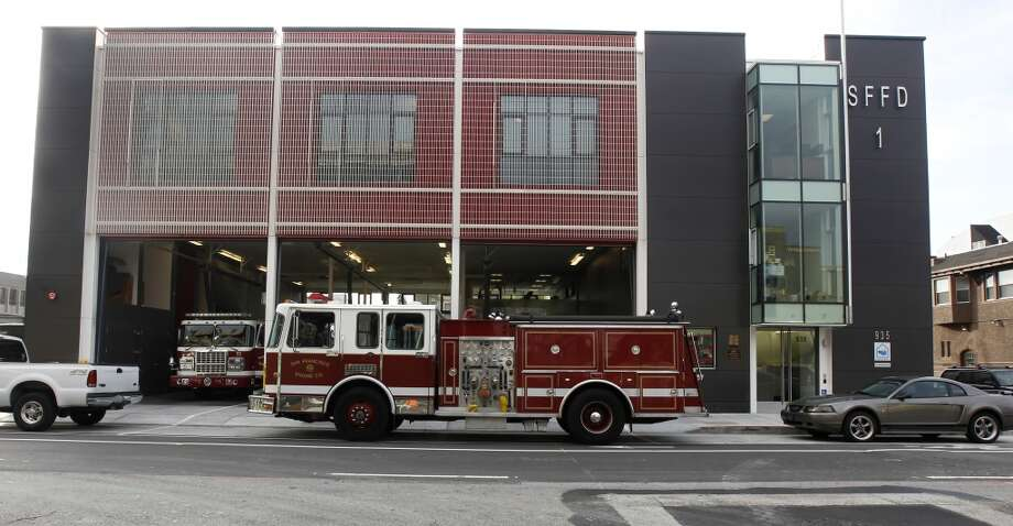 A file photo of firefighting equipment outside Fire Station No. 1 on Folsom Street in San Francisco.  A firefighter driving a ladder truck from the station struck a motorcyclist in June responding to a false alarm.  He is suspected of driving the vehicle drunk.