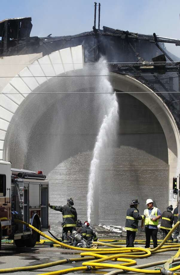 Firefighters battle a four-alarm blaze that severely damaged Pier 29 in San Francisco, Calif. on Wednesday, June 20, 2012.