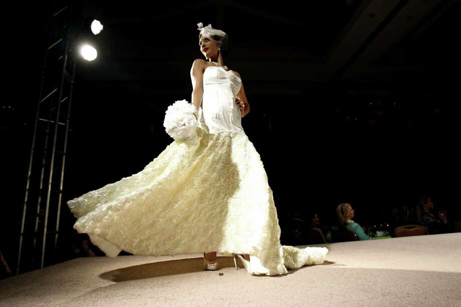 A model shows the finale piece of UIW design student  Ashley Pugh at Monday's Cutting Edge Fiesta Fashion Show. Pugh won first place in design and construction and best of show. Photo: Helen L. Montoya / San Antonio Express-News