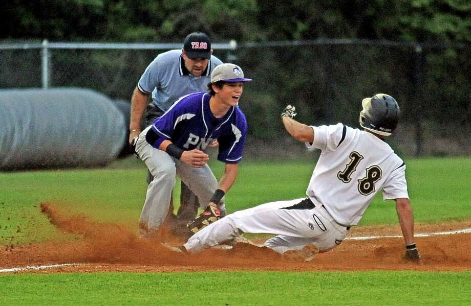 PN-G third baseman Mason Vizena, #15, tags out Carson Raines, #18, in a play at third during the Nederland High School baseball game against Port Neches-Groves High School on Tuesday, April 16, 2013, in Nederland. Photo taken: Randy Edwards/The Enterprise Photo: Randy Edwards