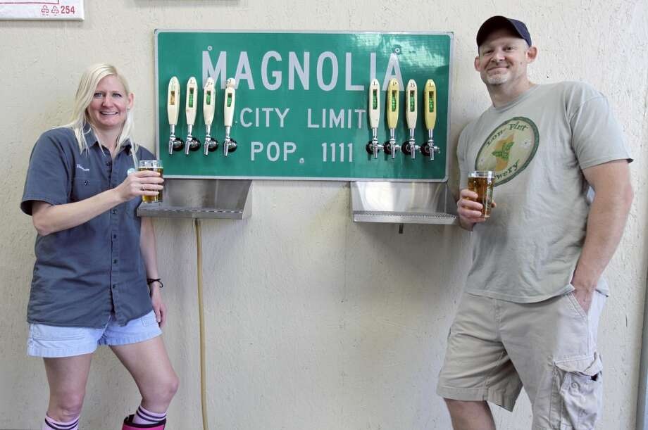 Lone Pint Brewery owners Heather Bolla and Trevor Brown during the inaugural tour of the Lone Pint Brewery, Saturday, April 20, 2013 in Magnolia.