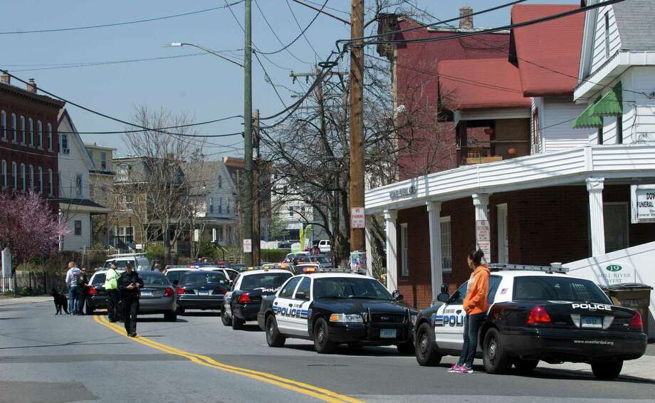 Stamford police officers and special response team members respond to a building on Stillwater Ave. where a man was reportedly in illegal possession of a firearm. Photo: Lindsay Perry / Stamford Advocate