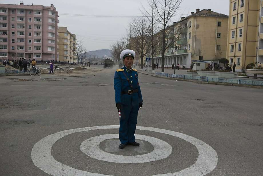 Rush hour in North Korea: A traffic cop mans a lonely intersection in Kaesong. Photo: David Guttenfelder, Associated Press