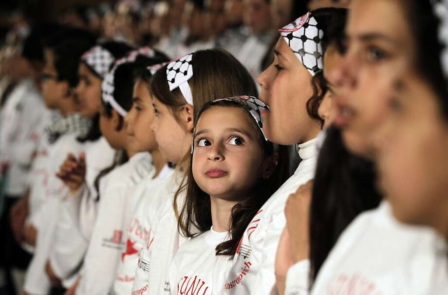 The sopranos: Palestinian choir girls sing at the al-Sununu (The Swallow) concert in Gaza City. The children attend a school funded by the United Nations Relief and Works Agency for Palestine Refugees. Photo: Mohammed Abed, AFP/Getty Images