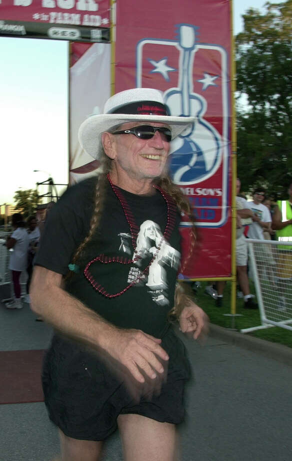 Willie Nelson in 2001 crosses the finish line at Auditorium Shores in Austin, Texas.  (AP Photo/Austin American-Statesman, Taylor Johnson) Photo: TAYLOR JOHNSON, Houston Chronicle  / AUSTIN AMERICAN-STATESMAN