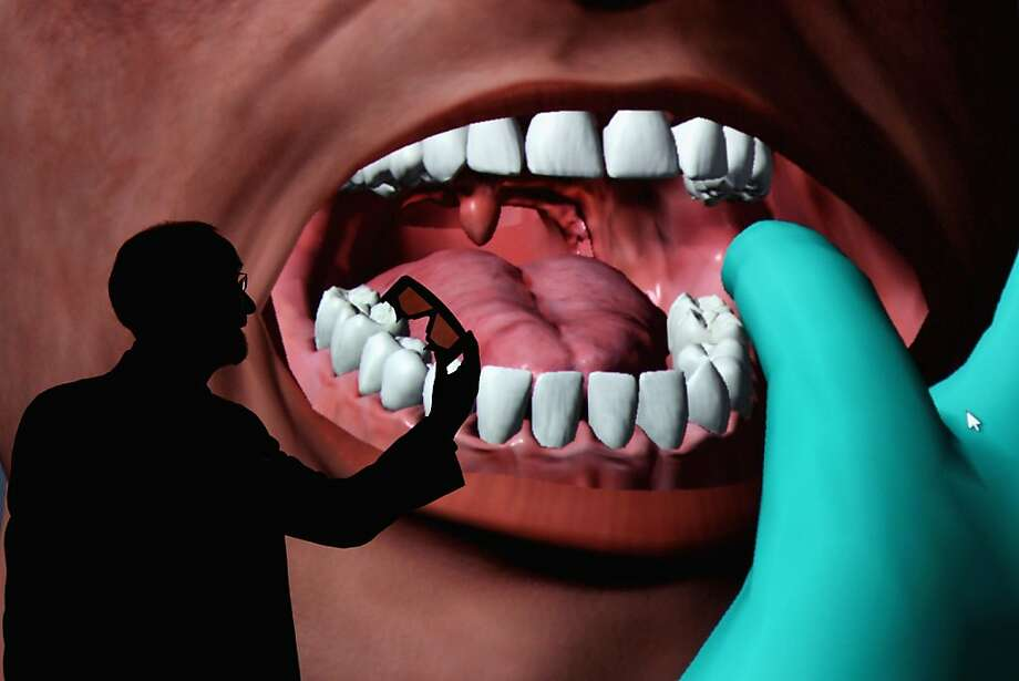 A uvula the size of a speed baghangs behind a bulging tongue in a 3D visualization of a human head in Glasgow, Scotland. Prof. Paul Anderson, director of Glasgow School of Arts Digital Design Studio, claims that the visualization will revolutionize medical and dental training by giving students the chance to examine afflictions on a giant scale. Photo: Jeff J Mitchell, Getty Images