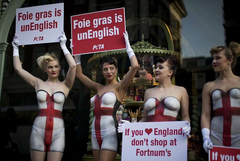 Pate crashers:PETA protesters wearing body paint and not much else picket London's Fortnum & Mason department store for selling foie gras imported from France. PETA contends that geese are abused in the production of liver pate. Photo: Matt Dunham, Associated Press
