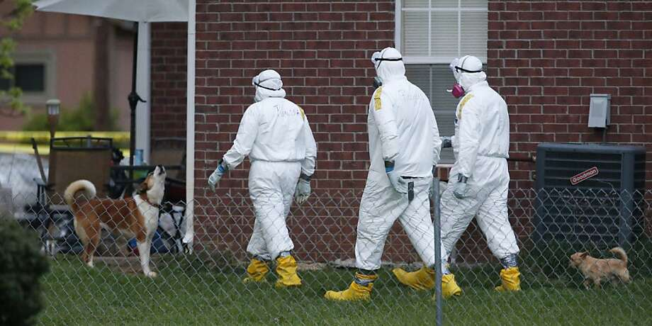 The ricin saga gets weirder: One of the Everett Dutschke's dogs howls as federal agents in hazmat suits inspect the grounds around his house in Tupelo, Miss. The investigation into ricin-laced letters mailed to President Obama and others shifted from Elvis impersonator Paul Kevin Curtis to Dutschke, Curtis' longtime foe. No charges have been filed against Dutschke, and he hasn't been arrested. Photo: Rogelio V. Solis, Associated Press