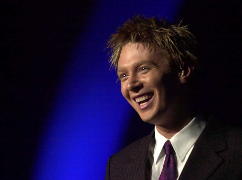 """Times Union photo by Lori Kane Albany, NY -- \""""American Idol\"""" runner-up Clay Aiken smiles at the crowd at a sold out concert at the Pepsi Arena on Monday, August 4, 2003."""