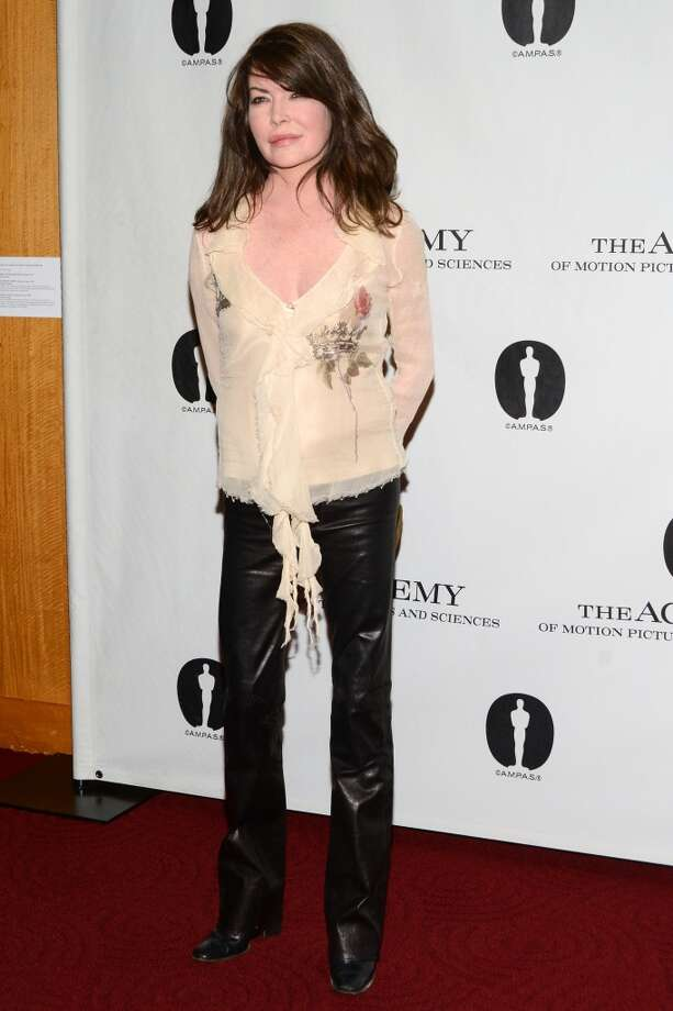 "Lara Flynn Boyle attends the Academy of Motion Picture Arts and Sciences hosts a ""Wayne\'s World\"" reunion  at AMPAS Samuel Goldwyn Theater on April 23, 2013 in Beverly Hills, California."