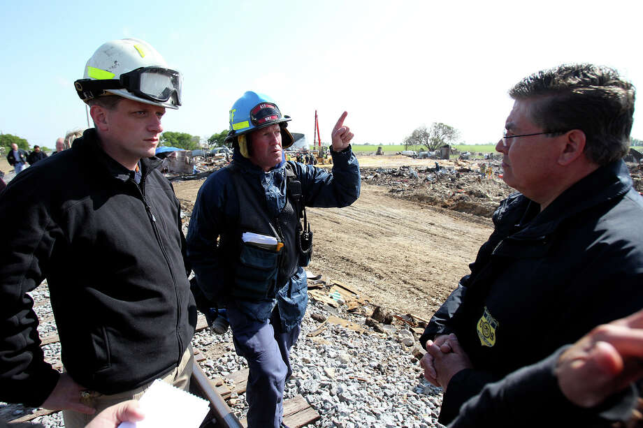 Brian Hoback with ATF explains details to Kelly Kistner , assistant state fire marshall, and Robert Champion, ATF at the site of the fire and explosion in West, Texas on  April 24 2013. Photo: TOM REEL