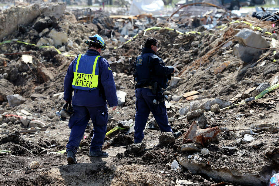 Agents walk in the crater at the site of the fire and explosion in West, Texas on  April 24 2013. Photo: TOM REEL