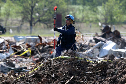 A forensic mapper works at the crater at the site of the fire and explosion in West, Texas on  April 24 2013. Photo: TOM REEL