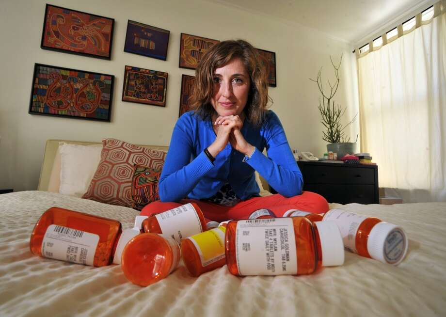 Jessica Goldman Foung displays some of the pills she takes to maintain her health at her home on April 19, 2013, in San Francisco. Foung, who has lupus and suffered kidney failure several years ago, was one of the reasons her family donated money to UCSF\'s artificial kidney project.
