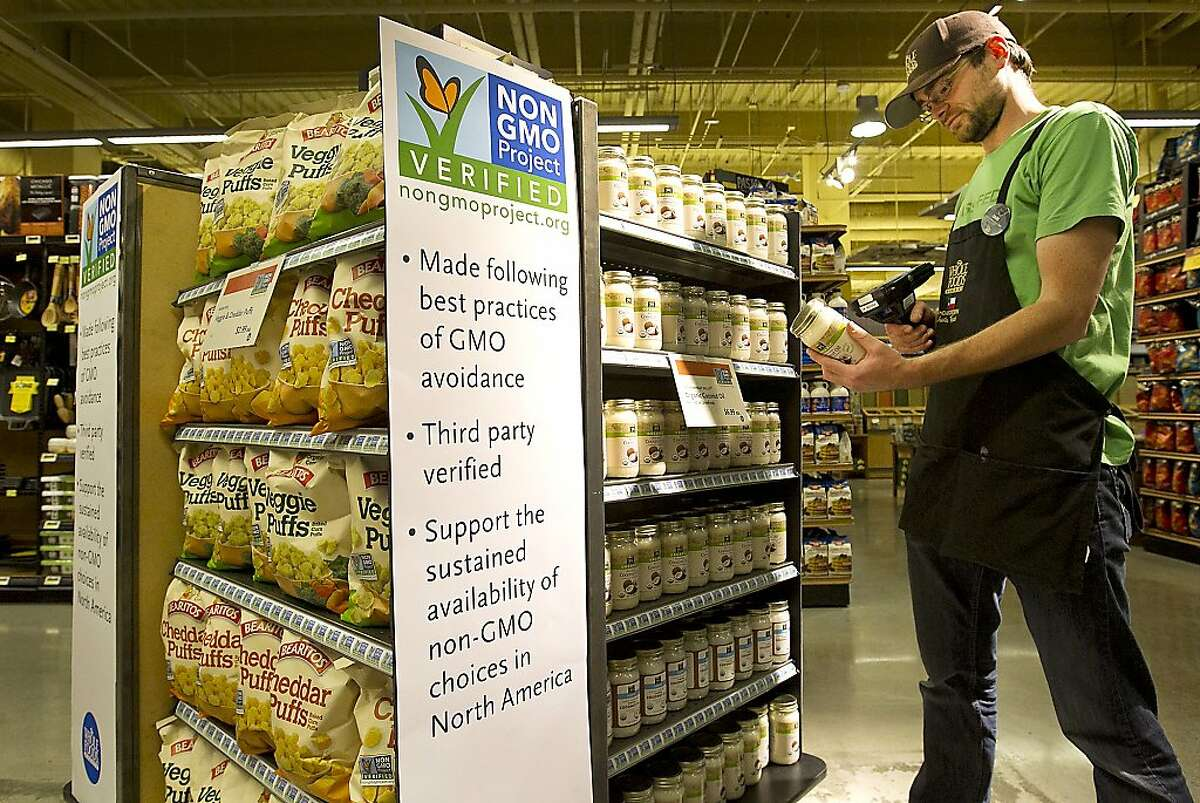 Ian Purdue scans non-GMO products at a Whole Foods Market in Austin, Texas.