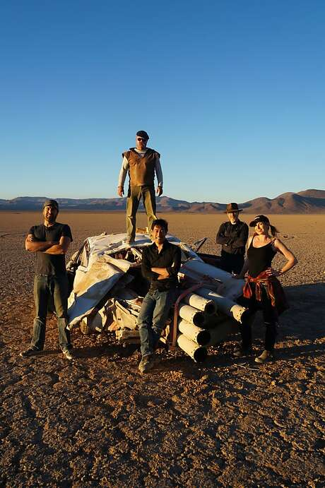Jamie Hyneman, Adam Savage, Tory Belleci, Grant Imahara and Kari Byron pose on the crashed JATO Rocket Car after testing. Photo: Discovery Channel