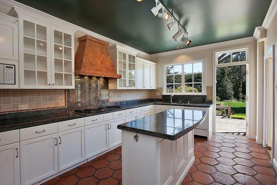 The kitchen features tile backsplashes and granite countertops. Photo: OpenHomesPhotography.com