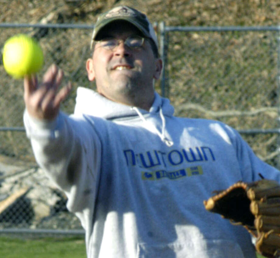 Carl Strait, hurler for the Pay It Forward men's slowpitch team, deals an enticing pitch on opening night for New Milford Parks & Recreation adult softball at Young's Field in New Milford. April 15, 2013 Photo: Norm Cummings