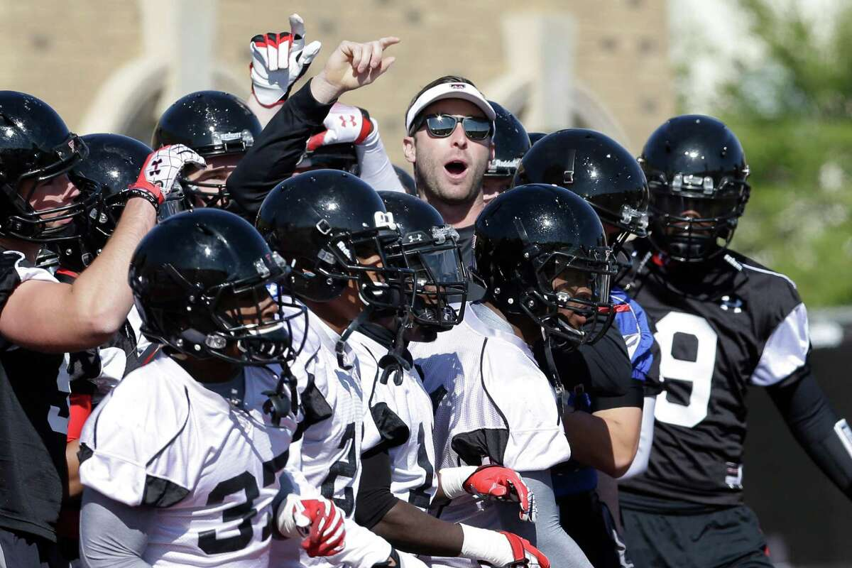 Texas Tech head football coach Kliff Kingsbury, center top, gets his team ready for a spring practice in Lubbock, Texas, Sunday, March 24, 2013. At 33-years-old, the former Texas Tech star quarterback is the youngest head coach of a BCS school heading into his first year as leading the football program. (AP Photo/LM Otero)