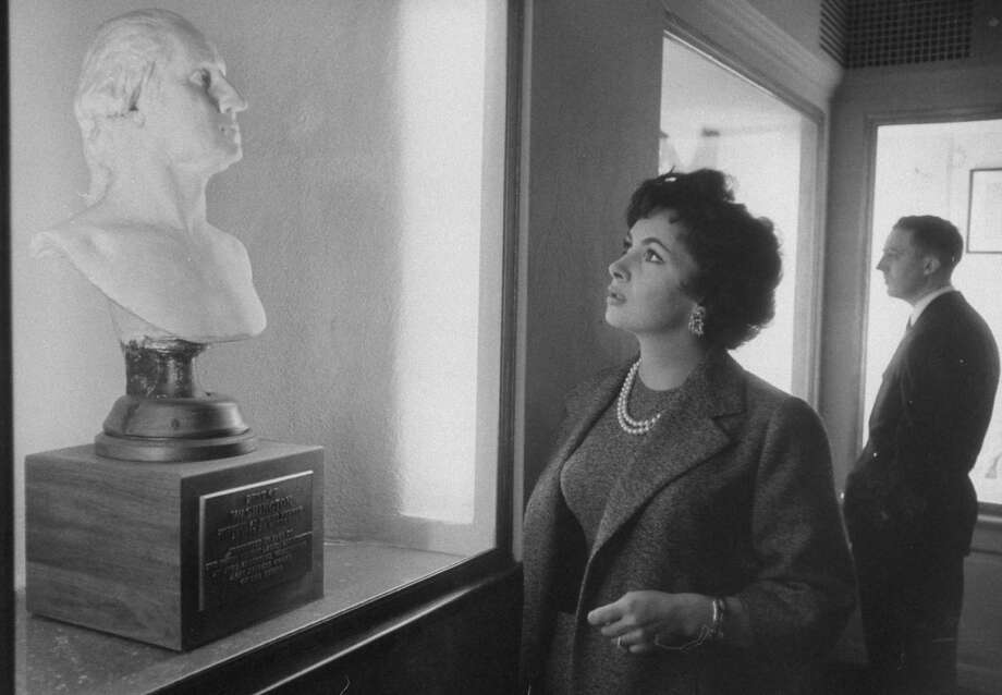 Actress Gina Lollobrigida looks at a bust of George Washington at Mount Vernon in 1958. Photo: Ed Clark, Time & Life Pictures/Getty Image / Time Life Pictures