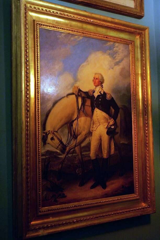 A painting of George Washington hangs in his Mount Vernon Estate on December 4, 2004. Photo: Joe Raedle, Getty Images / 2004 Getty Images