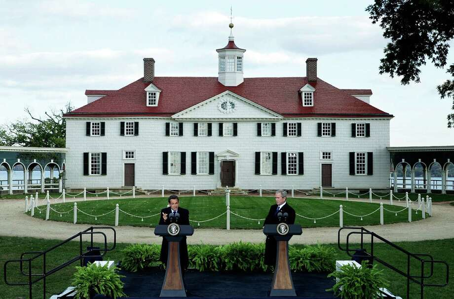 French President Nicolas Sarkozy (left) speaks as U.S. President George W. Bush listens during a joint press availability at George Washington's mansion  in Mount Vernon, Va., on November 7, 2007. Photo: Alex Wong, Getty Images / 2007 Getty Images