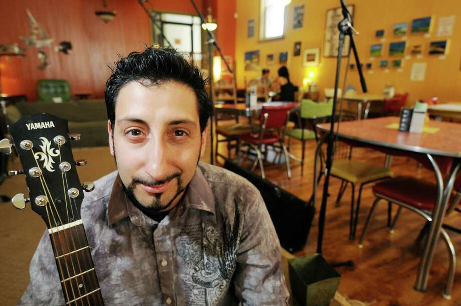 Sal Prizio, the programming manager for the Massry Center of the Arts, was appointed consulting executive director of the Cohoes Music Hall in April 2013. Prizio is shown at the former Bread and Jam Cafe on Remsen Street in Cohoes in this August 2010 archive photo.   (Times Union archive) Photo: LUANNE M. FERRIS / 00009686A