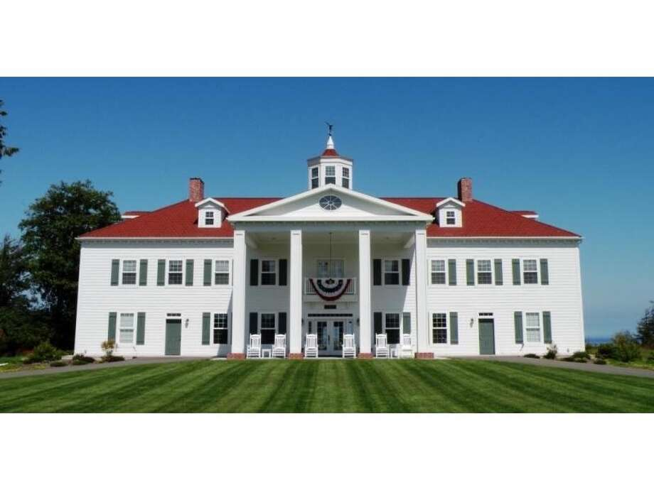 Want to live like George Washington, with paying guests? The George Washington Inn, at 939 Finn Hall Road, in Port Angeles, doesn't exactly recreate the 18th-century lifestyle. But it is a convincing replica of Mount Vernon, the first president's Virginia estate. The 10,000-square-foot bed and breakfast, built in 2002, has eight bedrooms, eight bathrooms, a theater, decks, patios, a geothermal heating system, water and mountain views, outbuildings and a helipad on an 11-acre lavender farm along the Strait of Juan de Fuca. It's listed for $3 million. Read more about the inn here. Click on for more pictures of the inn, followed by shots of Mount Vernon. Photo: Courtesy Sam Cunningham, Sandy Justen And Julie Biniasz, Realogics Sotheby's International Realty